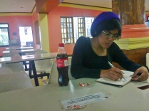 Ria writing on her jourplanner, Pilandok